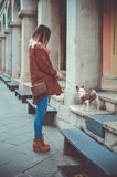 Fashionable woman with pet dog