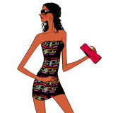 Fashionable woman with a pink clutch bag. Beautiful lady posing Royalty Free Stock Images