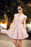 Fashionable Woman in Pink Suit with Skirt and Sunglasses Stock Photography