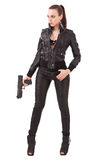 Fashionable woman with a pistol. Elegant fashionable woman with a pistol in hands Royalty Free Stock Photography