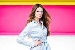 Fashionable woman portrait. A portrait of a pretty fashionable Russian woman on a pink yellow white background Stock Image