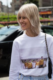 Fashionable woman posig during Milan Men's Fashion Week Stock Image