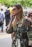 Fashionable woman posing during Milan Fashion Week Royalty Free Stock Photo