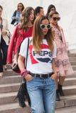 Fashionable woman posing during Milan Fashion Week Stock Photos