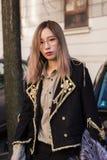 Fashionable woman posing at Milan Men`s Fashion Week Royalty Free Stock Photo