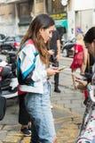 Fashionable woman posing during Milan Women`s Fashion Week stock photos