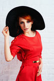 Fashionable woman posing in red dress Stock Images
