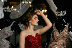 Fashionable woman posing in red gown Royalty Free Stock Photos