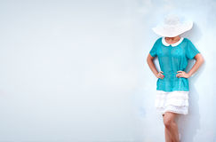 Fashionable woman posing at white wall Stock Photography