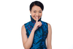 Fashionable woman putting a finger on her lips Royalty Free Stock Photo