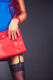 Fashionable woman with a red bag Royalty Free Stock Image
