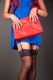 Fashionable woman with a red bag Royalty Free Stock Photos