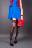 Fashionable woman with a red bag Stock Image
