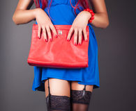Fashionable woman with a red bag Stock Photo