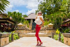 Fashionable woman in red leather pants and high heels. Fashionable woman in red leather pants and red high heels Royalty Free Stock Photography