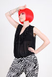 Fashionable woman in red wig Royalty Free Stock Images