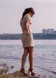 Fashionable woman by sea Stock Photo