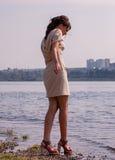 Fashionable woman by sea Stock Photo