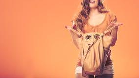 Fashionable woman searching through handbag. Royalty Free Stock Photo