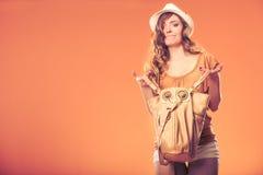 Fashionable woman searching through handbag. Stock Images