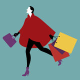 Fashionable woman with shopping bags walking on the street. Vector Illustration Stock Photos