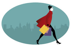 Fashionable woman with shopping bags walking on the street. Vector Illustration Royalty Free Stock Photography