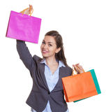 Fashionable woman showing a shopping bag Stock Photos