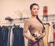 Fashionable woman in a showroom Stock Images