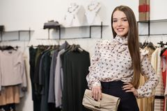 Fashionable woman in a showroom Stock Photo