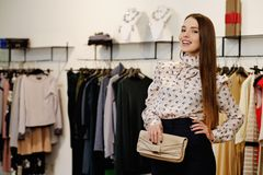 Fashionable woman in a showroom Royalty Free Stock Photography