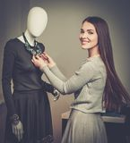 Fashionable woman in a showroom Stock Image