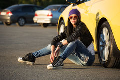 Fashionable woman sitting on the car parking Royalty Free Stock Image