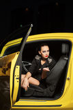 Fashionable woman smoking cigarette in a car Stock Images