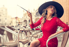 Fashionable woman smoking cigarette in style Royalty Free Stock Images