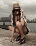 Fashionable woman squatting Royalty Free Stock Image