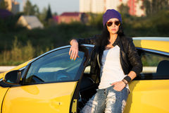 Fashionable woman standing at the car Royalty Free Stock Photo