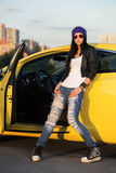 Fashiona woman standing at the car Royalty Free Stock Photos