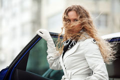 Fashion woman standing at the car Stock Image