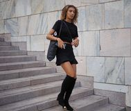 MILANO, Italy: September 21, 2018: Fashionable woman in street style outfit on Arengario stairs royalty free stock image