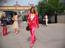 MILAN, Italy: 19 september 2018: Fashionable woman in streetstyle outfit. Fashionable woman in streetstyle outfit after Alberto Zambelli fashion show during royalty free stock photos