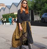 MILAN, Italy: 19 september 2018: Fashionable woman in streetstyle outfit. Fashionable woman in streetstyle outfit after Alberto Zambelli fashion show during stock photos