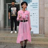 MILAN, Italy: September 22, 2018:Fashionable woman streetstyle outfit. Fashionable woman streetstyle outfit after Philosophy di Lorenzo Serafini fashion show royalty free stock photos