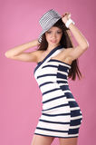 Fashionable woman in stripped hat and dress Royalty Free Stock Photography
