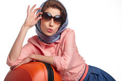 Fashionable woman with a suitcase travel Stock Photos