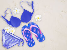 Fashionable woman swimming suit and flip flop on sand beach back Royalty Free Stock Images