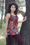Fashionable woman by tree Stock Photo