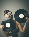Fashionable woman with two vinyl LP records Stock Photo