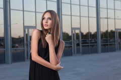 Fashionable woman on urban background stock photos