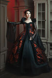 Fashionable woman in a vintage style. Retro baroque fashion woman in a magnificent dress Stock Images