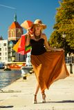 Fashionable woman walking with shopping bags Stock Photo
